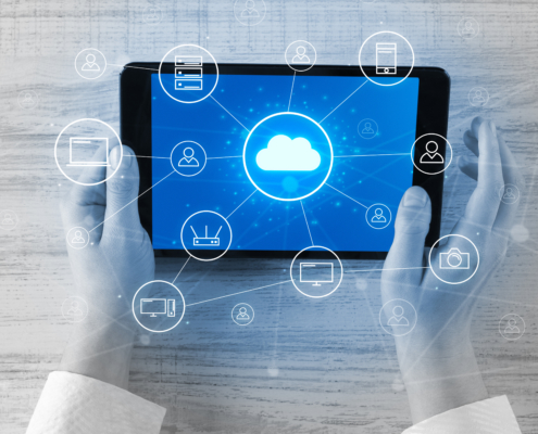 Hand touching tablet with cloud computing and online storage concept